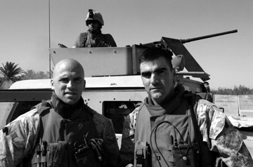 1st Sgt. Chris Reed and Capt. Bill Allen IV prepare for a mission to Al Taqaddum Airbase. Reed was attacked with an IED as he returned. No one was injured.