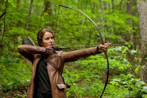 Jennifer Lawrence wields her weapon of choice in The Hunger Games.