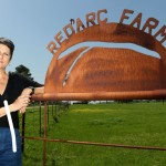 The Crawfords' iconic Red'Arc Farm sign traces the path of the Bois d'Arc Creek as it empties into the Red River.