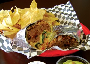 You'll need a knife and fork to get at Mojo's pulled pork burrito. Bonnie Mays