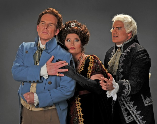 Soprano Carter Scott stars as Tosca, with tenor Roger Honeywell as Cavaradossi (left) and baritone Michael Chioldi as Scarpia, in Fort Worth Opera's production of the Puccini classic.