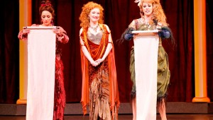 Ava Pine (center) presides while Ashley Kerr and Alissa Anderson proclaim their celibacy pledge in Fort Worth Opera's production of Lysistrata.