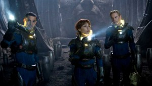 "Logan Marshall-Green, Noomi Rapace, and Michael Fassbender puzzle out the meaning of an alien civilization's artifacts in ""Prometheus."""