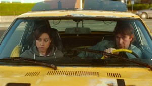 "Aubrey Plaza and Mark Duplass ride in a vehicle that is not a time machine in ""Safety Not Guaranteed."""