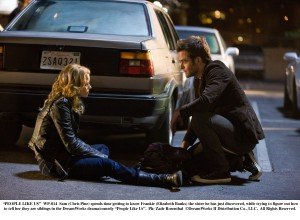 "Elizabeth Banks and Chris Pine meet in the parking lot outside an AA meeting in ""People Like Us."""