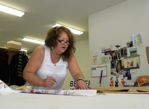 Kelli Belindo designs clothing at her space in The Work Room on Race Street.  Lisa Maria Garza