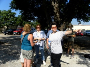 Stein (pointing) and a group of volunteers plan the layout of the community garden.  Lisa Maria Garza