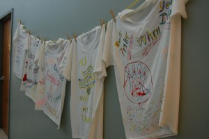 T-shirts decorated by survivors of domestic violence line the walls inside the SafeHaven location in Arlington.