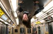 Andrew Garfield hits the ceiling of a New York City subway car in The Amazing Spider-Man.