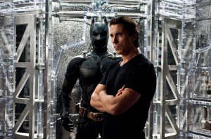 Christian Bale ponders the end of Batman in The Dark Knight Rises.