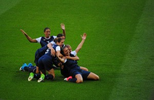 The U.S. women's soccer team celebrates after their first goal in the 2012 Olympic final.