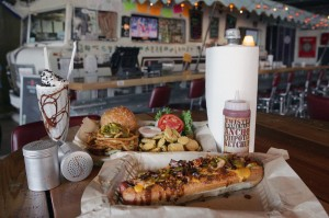 The Winnebago bar provides a quirky backdrop for some of Twisted Root's signature items, including the Dirk Diggler Dog (front). Lee Chastain