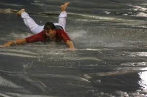 Rain turned an infield tarp into a huge Slip 'n Slide.