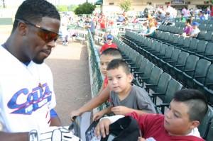 Children have little trouble wangling autographs at LaGrave Field.