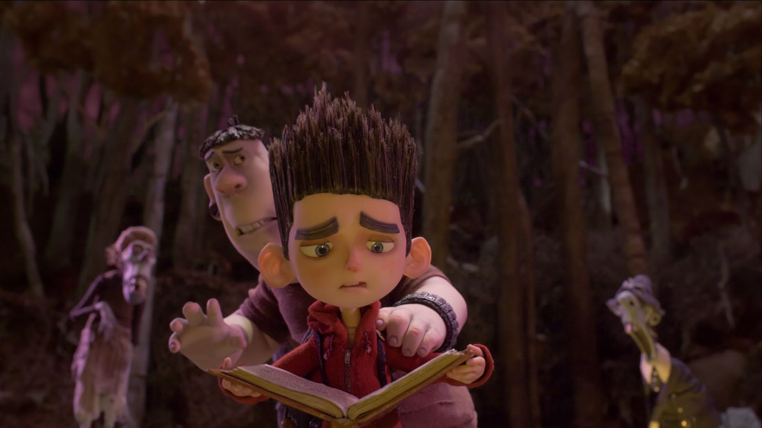 School bully Alvin cowers behind Norman as he tries to read the incantation that'll stave off the walking dead in ParaNorman.