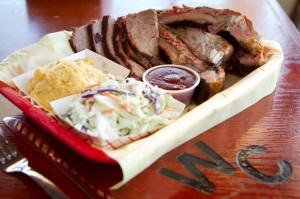 Pork ribs and brisket liven up this two-meat plate at Woody Creek. Tony Robles