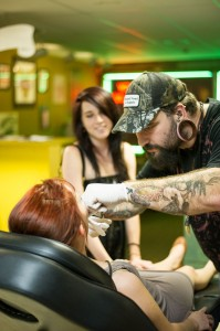 When you get a tattoo at Salty Dog Tattoo, the artists' work is on display — on the artists. Brian Hutson