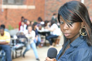Trimble Tech senior Tempie Love sings in the courtyard as part of an open-mic event. Jeff Prince