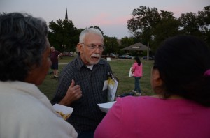 Terry Thompson, a Democratic precinct chair, passes out voter registration forms at a gathering in South Hemphill Heights.
