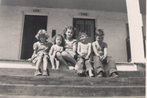 The three George children shared a side porch along Montgomery Street with neighbors in the fall of 1952. Courtesy Sylvia Belle George Walls