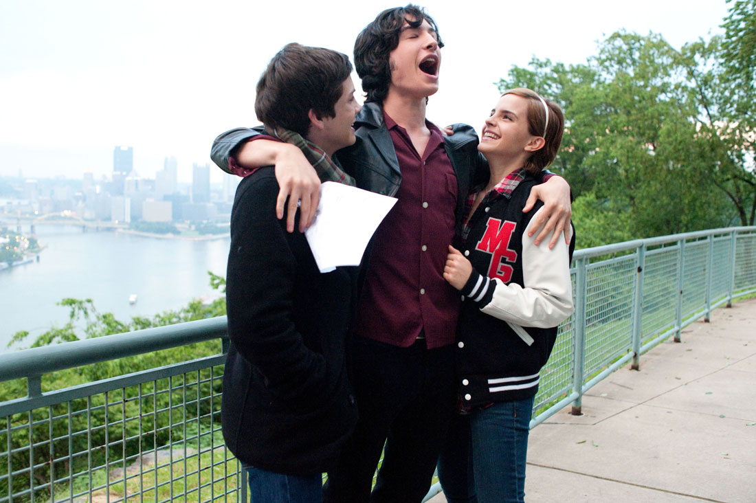 Logan Lerman, Ezra Miller, and Emma Watson celebrate a high-school triumph in The Perks of Being a Wallflower.