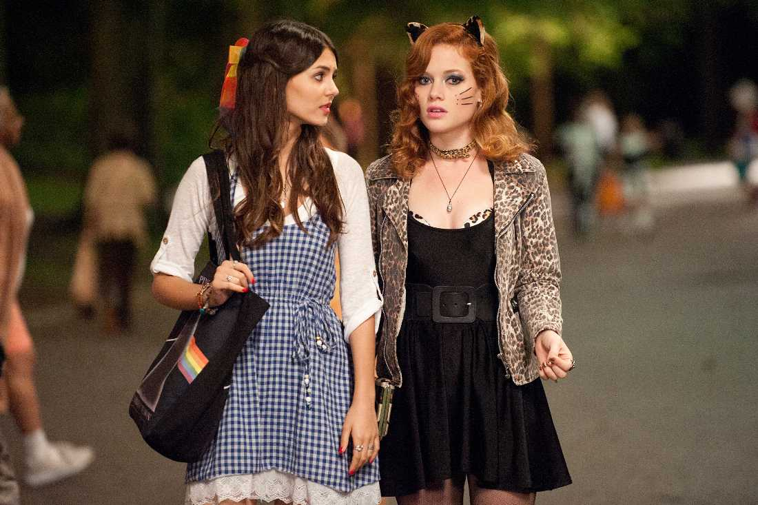 "Victoria Justice (dressed as Dorothy from ""The Wizard of Oz"") and Jane Levy (dressed as a sexy cat) search for a little boy on Halloween in ""Fun Size."""