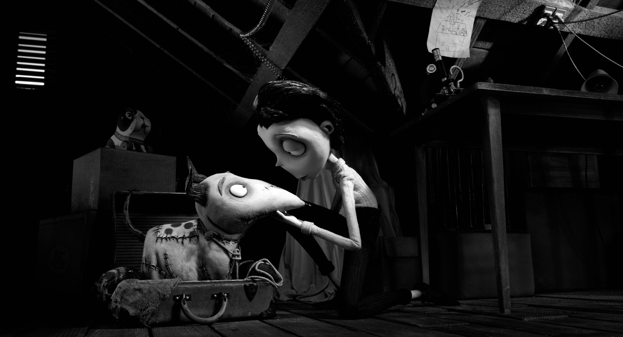 "What's a Tim Burton movie without an attic? Young Victor Frankenstein curls up with a resuscitated Sparky in ""Frankenweenie."""