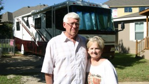 Richard and Ginger Moore are living in the recreational vehicle behind them. Jeff Prince
