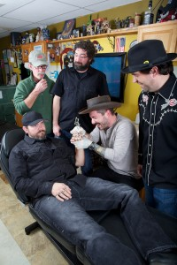 Holy Moly drummer Joe Carpenter gets some ink from frontman Joe Rose.