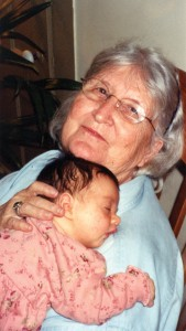 Brink cuddles one of her 19 great-grandchildren.