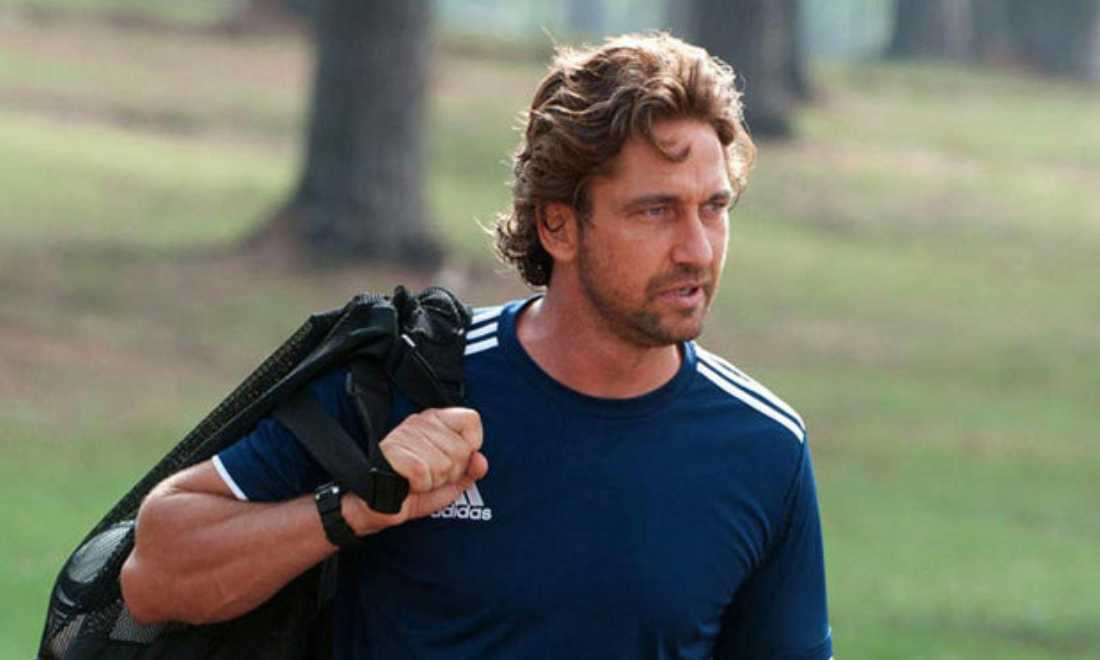 Gerard Butler prepares to hit the practice field in