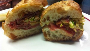 The cherry-wood smoked bacon, prosciutto, and Eagle Mountain gouda sandwich is available at Magnolia Cheese Company.