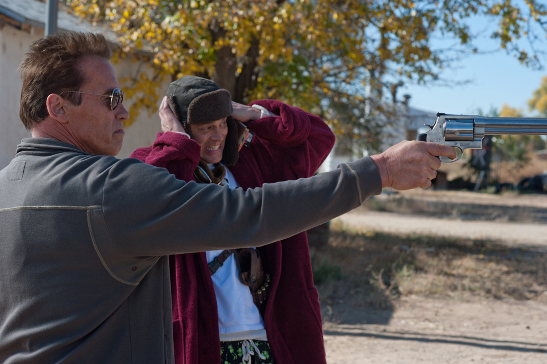 Arnold Schwarzenegger and Johnny Knoxville handle a big-ass gun in The Last Stand.