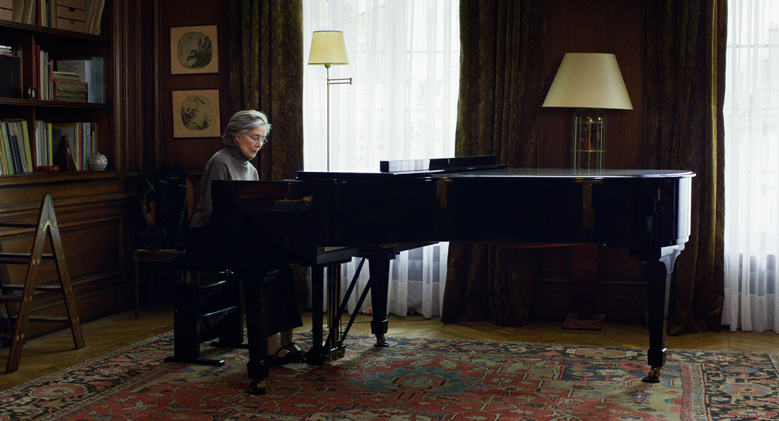 Emmanuelle Riva plays piano in her home before illness strikes in Amour.