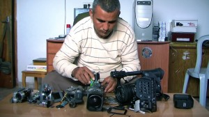 Emad Burnat examines 5 Broken Cameras at Thin Line Film Fest.