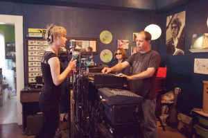 Schuyler Stapleton (left) records vocals with Jennifer and Robby Rux.