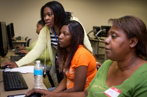 Denise Gonder (standing) helps (left to right) Tiahna Tapp, Latoya Brice, and Sallie Hannie with resumé writing, in the Healthy Start program.