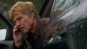 Robert Redford makes a phone call before the cops can trace his signal in The Company You Keep.