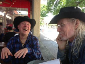 Bill Werngren (left) and James Michael Taylor hang out in the Stockyards. Courtesy Jeannette Stewart