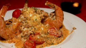 The Flame takes on shrimp scampi — lookin' good. Lee Chastain