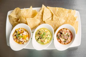 Waters' ceviche trio, with shrimp, striped bass, and ahi tuna, awaits. Adrien P. Maroney