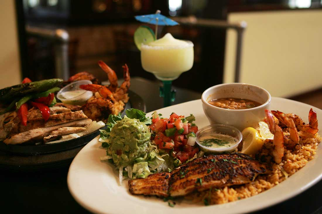 Don Mario's serves up their Ultimate Fajitas (left) and a platter of catfish and shrimp. Lee Chastain