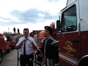 Goodwin (left) finishes putting on his dress uniform for a memorial service in Waco. Next to him is Brent Batla, a Burleson firefighter and one of 300  pipers who played at the service. Courtesy Grace Goodwin