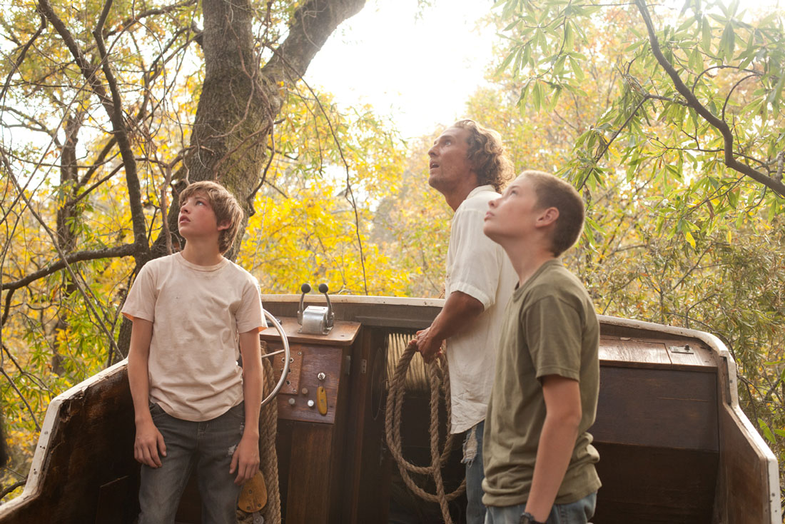 Tye Sheridan, Matthew McConaughey, and Jacob Lofland are up a tree (in a boat) in Mud.