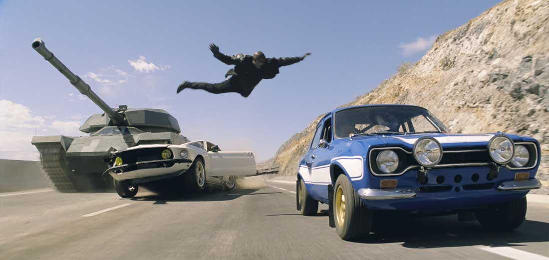 Yep, that's Tyrese Gibson leaping onto a speeding car to avoid being crushed by a tank in Fast & Furious 6.