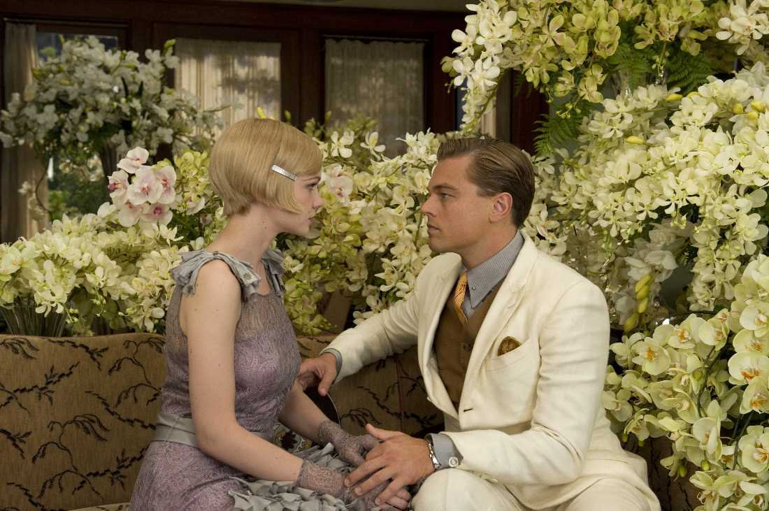 An explosion of flowers frames Carey Mulligan and Leonardo DiCaprio's romance in