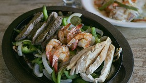 Steak, shrimp, and chicken fajitas are waiting at Flamingo's. Lee Chastain