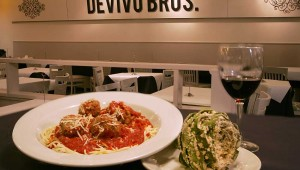 Funky and chunky: DeVivo's spaghetti and meatballs keep company with a stuffed artichoke. Lee Chastain