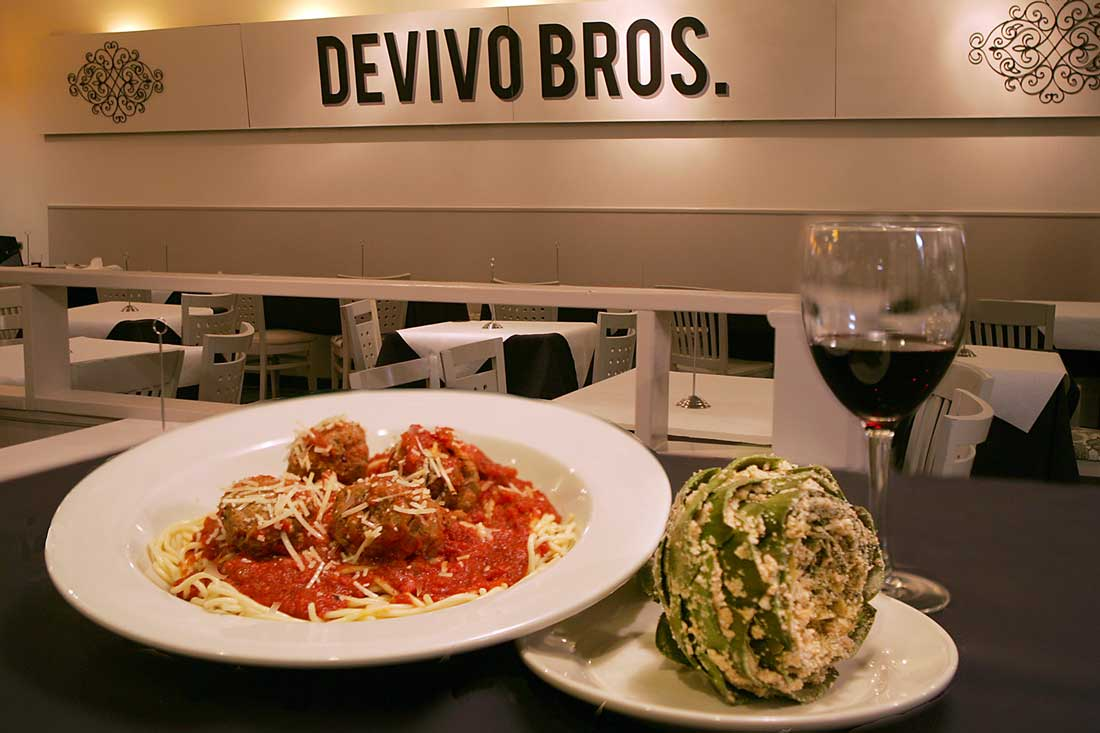 Funky and chunky: DeVivo's spaghetti and meatballs keep company with a stuffed artichoke. Lee Chastain