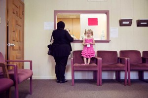 A patient checks out at the MCC clinic with her young daughter. The center helps Muslim families with everything from dental care to referrals for social services.